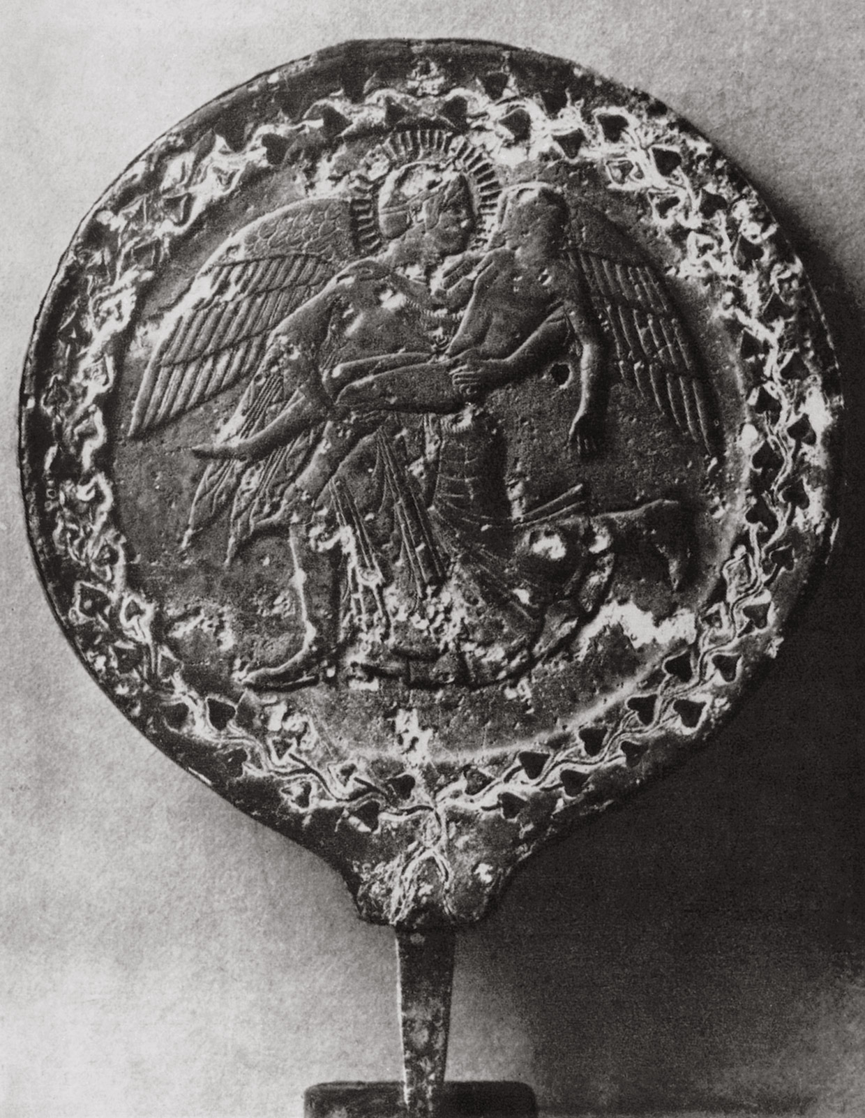 Winged Eos, bearing Cephalus in her arms. Mirror with a relief adornment. Bronze. 5th century BCE. Rome, Vatican Museums