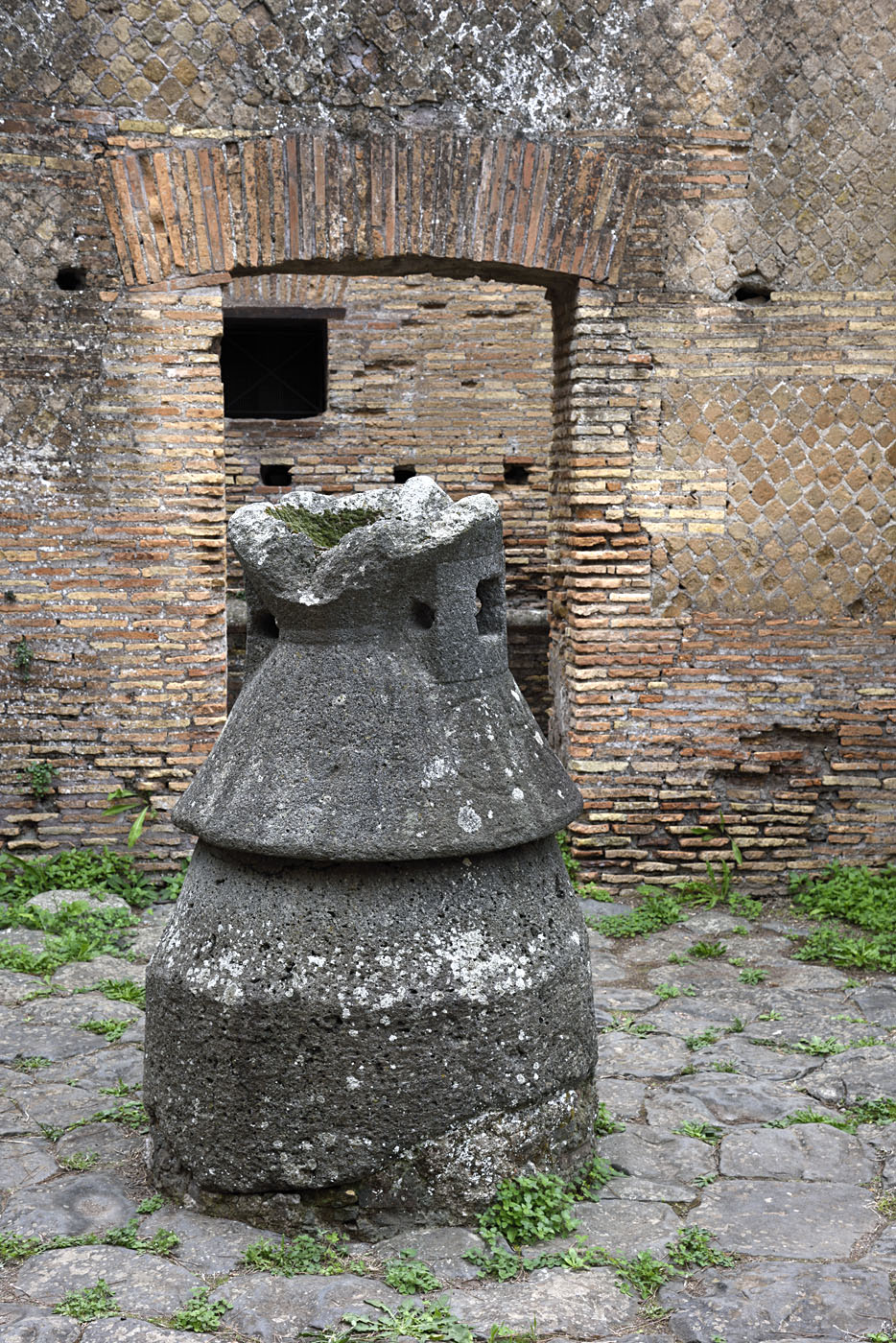 Mill in the bakery on the Via dei Mulini. Volcanic stone. 2nd century CE. Ostia, Archaeological site (I, III, 1)