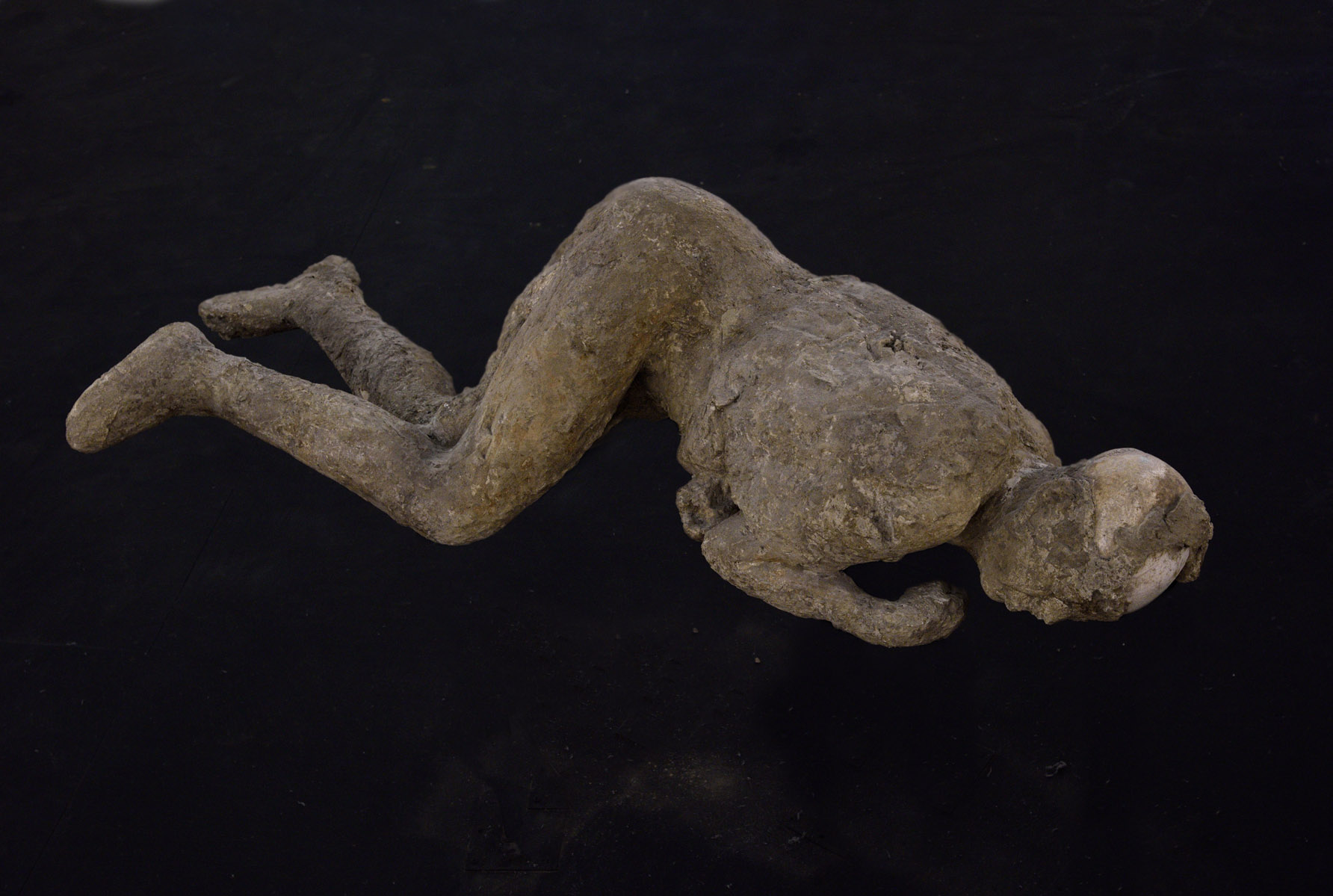 Plaster cast of body of a victim of Vesuvius eruption of 79 CE.  Pompeii