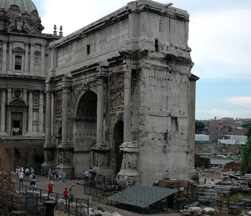 Arch of Septimius Severus. View from the side of Capitolium. Rome, Roman Forum, Arch of Septimius Severus