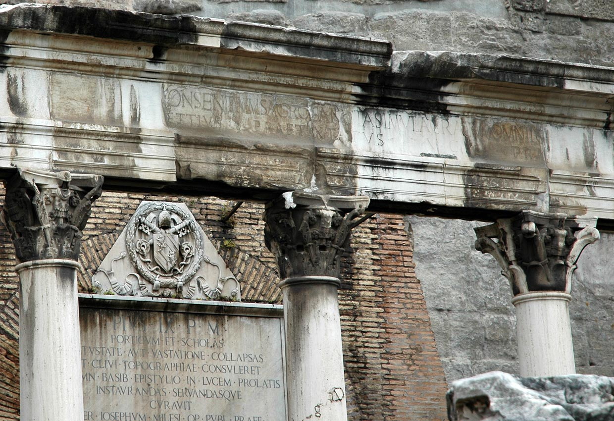 Portico of the Dei Consentes. Architrave with an inscription and the Corinthian capitals with the image of trophies. Rome, Roman Forum