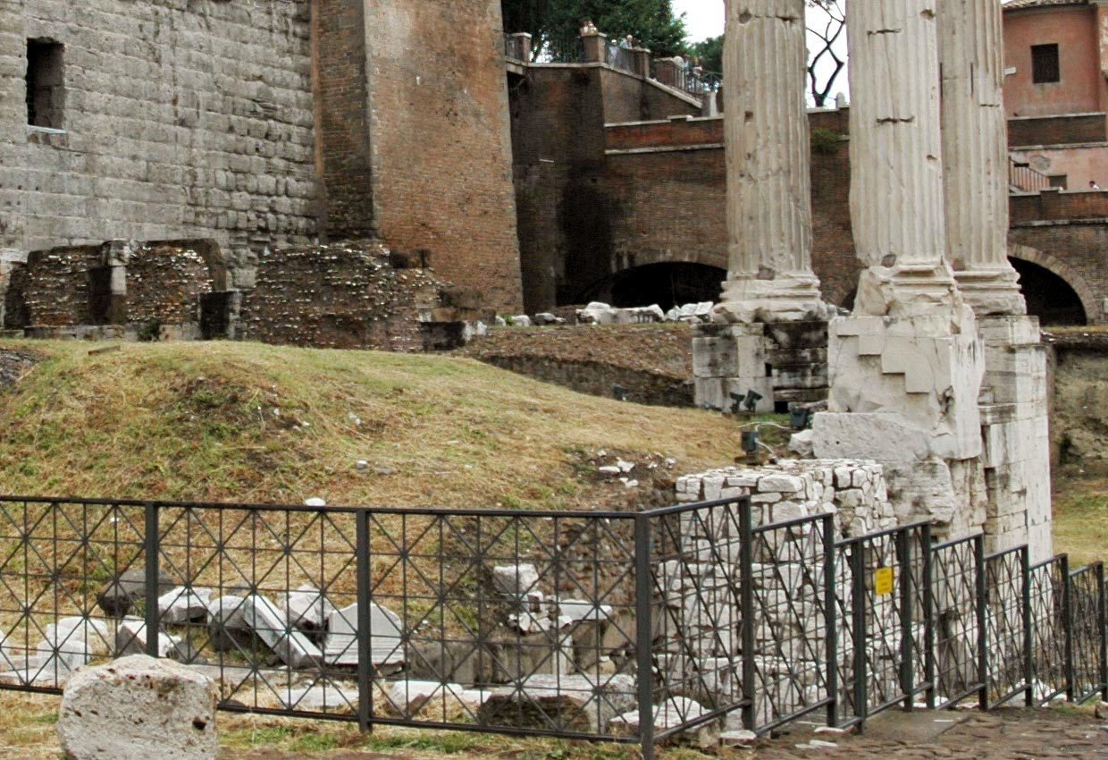 The temple of Vespasian and Titus. The basis of temple. Rome, Roman Forum