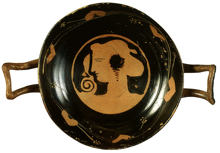 Head of a woman. Red-figure Kylix. Attic. By the Diomedes Painter. Clay. First half of the 4th century BCE. Height 5.3 cm, diameter of cup with handles 22 cm. Inv. No. Б. 283. Saint Petersburg, The State Hermitage Museum