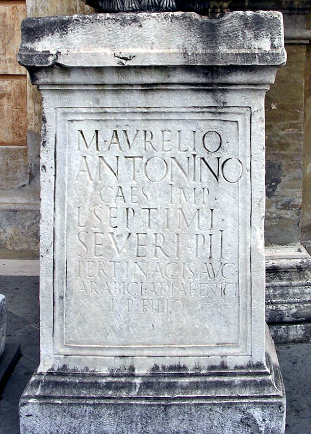 The honorific inscription for Caracalla. White fine-grained marble. 196 CE.  CIL XIV 121 = CIL VI 1050. Inv. No. 22639. Rome, Vatican Museums, Court of the Pigna