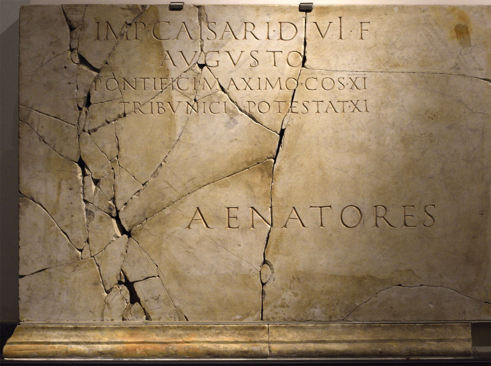 Inscription from the Curiae Veteres in honour of emperor Augustus. CIL. VI. 40307 = AE. 1996. 246. Luna marble. 55—56 CE.  Hall 5, Inv. No. 574363. Rome, Roman National Museum, Baths of Diocletian