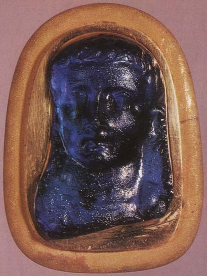 Tiberius. Fragment of a blue glass phalera. Early 1st century. 3 × 3 cm. Inv. No Ж 272. Saint Petersburg, The State Hermitage Museum