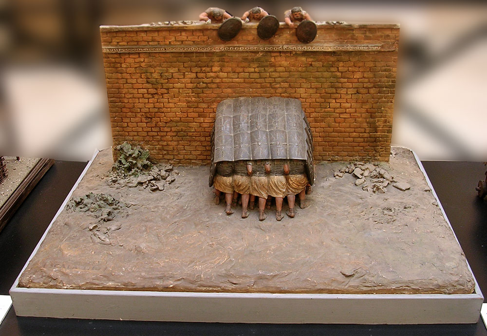 Scale model (1:10) of a tortoise (testudo), a battle formation in which soldiers marching in close ranks protected themselves with their shields raised above their heads. Inv. No. MCR 893. Rome, Museum of Roman Civilization