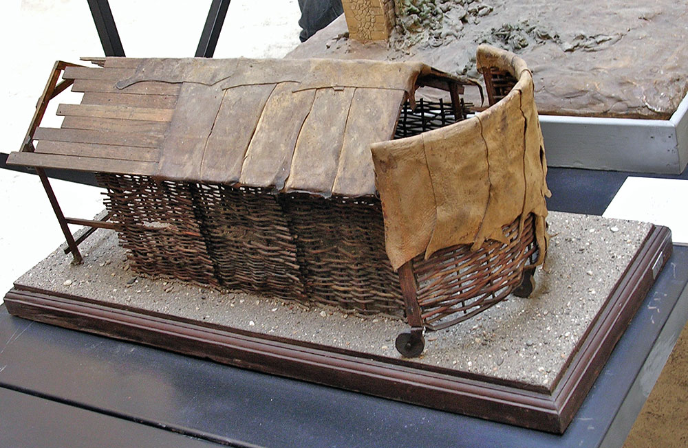Scale model (1:10) of a vinea, a military engine used to protect the troops, consisting of a wooden framework, roof and lattice sides covered with fresh hides or wet sheets of cloth. Inv. No. MCR 894. Rome, Museum of Roman Civilization