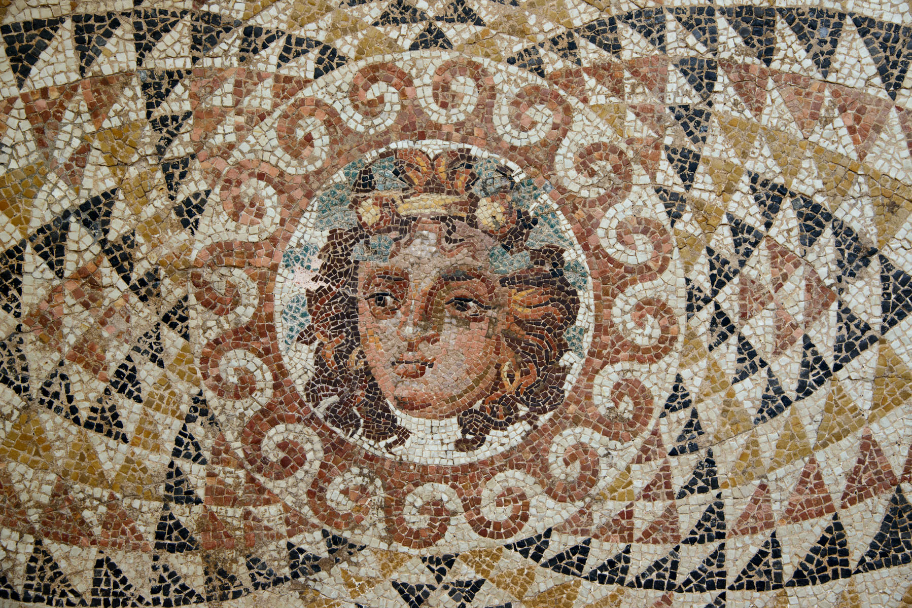 Mosaic floor with Dionysus' head. From a Roman villa. Second half of the 2nd—3rd cent. CE. Inv. No. A609 / MOS 25-3. Corinth, Archaeological Museum of Ancient Corinth