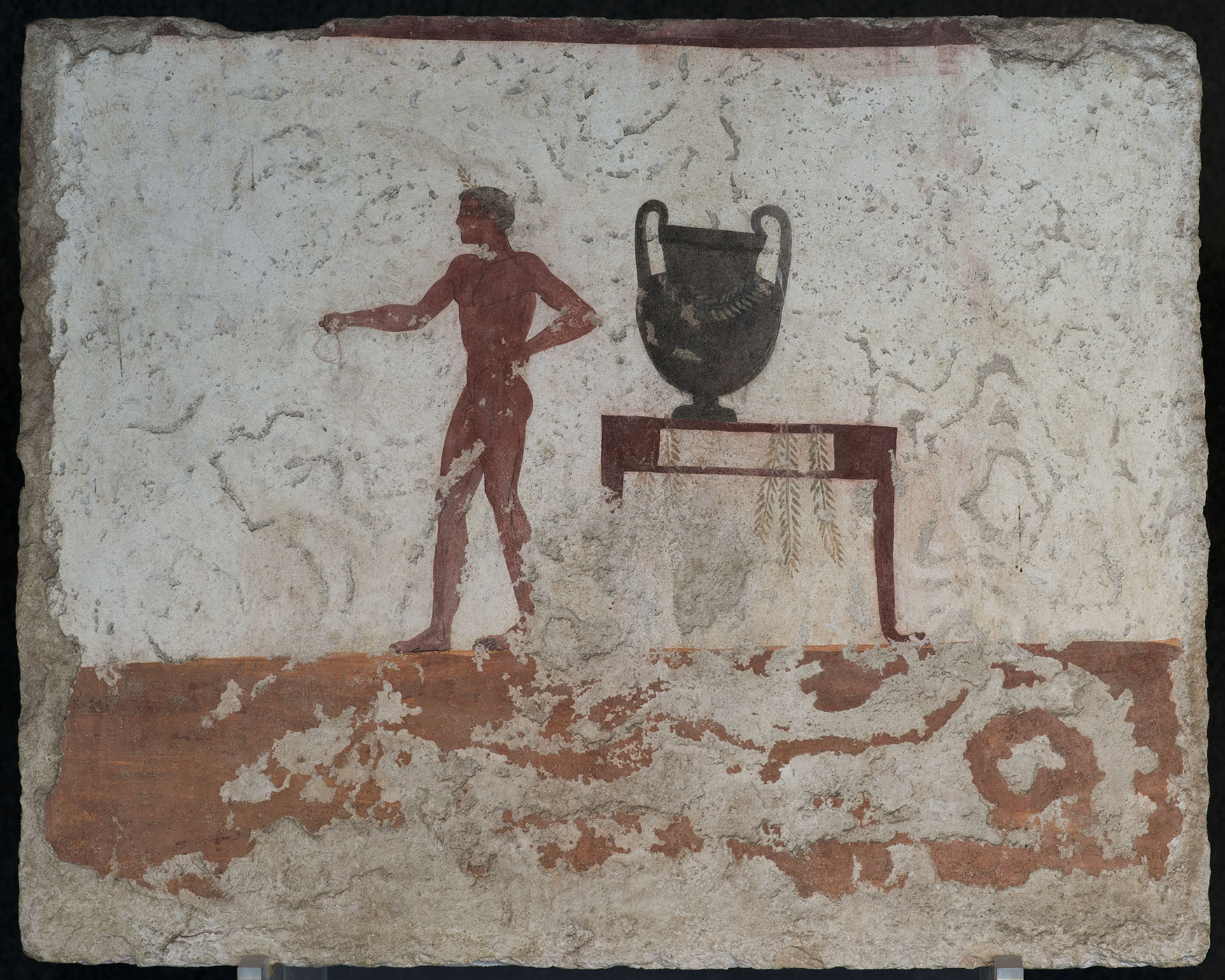 Wine-pourer at krater. Fragment of scene of the symposium. The east inside wall of sarcophagus from Tomb of the Diver. Fresco. Ca. 480 BCE. Paestum, National Archaeological Museum