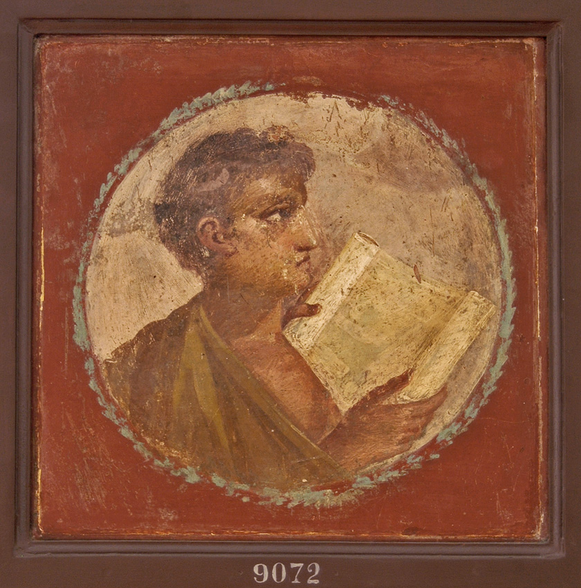 Medallion depicting the bust of youth with scroll. Fresco from Herculaneum. Fourth style. 55—79 CE.  Inv. No. 9072. Naples, National Archaeological Museum