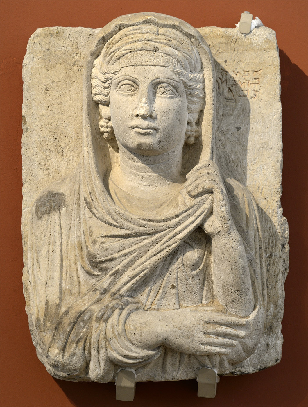 Grave stele of Abkha, the daughter od Akhou from Palmyra. Syria, Palmyra, ca. mid-2nd cent. CE. Sandstone. Inv. No. 1a 647. Moscow, the Pushkin Museum of Fine Arts