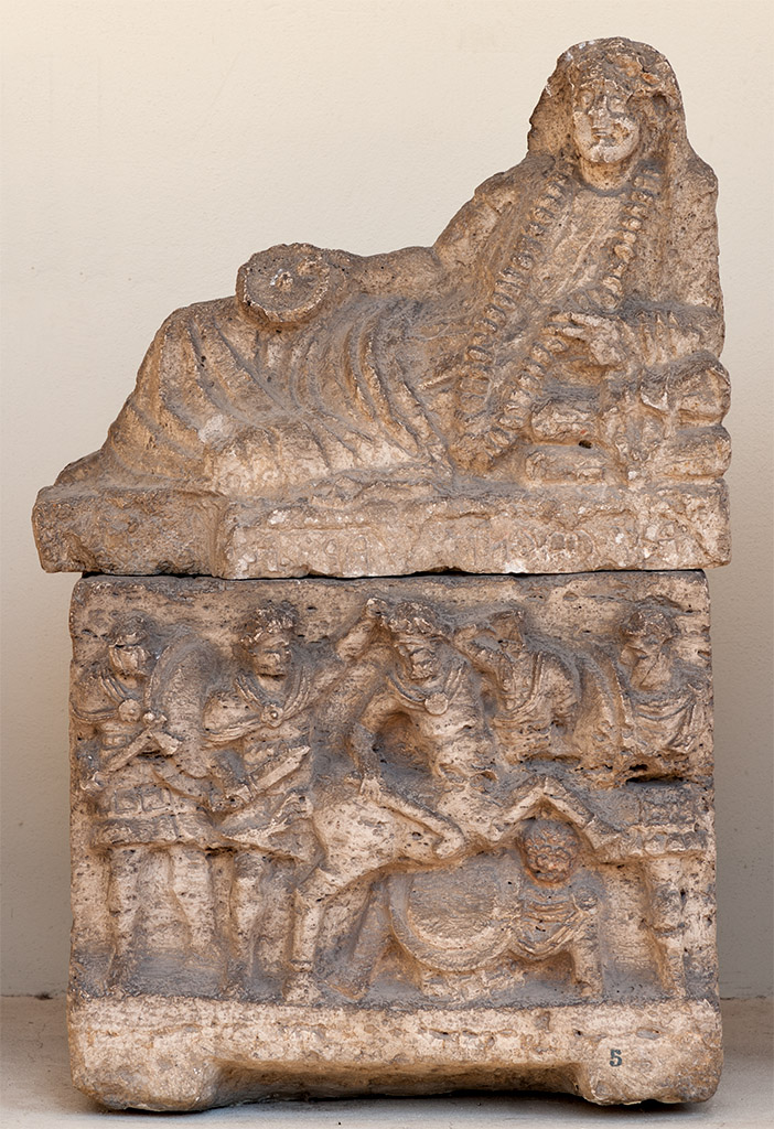 Cinerary urn of Aule Cacni with a scene of a battle between the centaurs and the Greeks. Travertine. 2nd century BCE. Inv. No. Com. 5. Perugia, National Archaeological Museum of Umbria