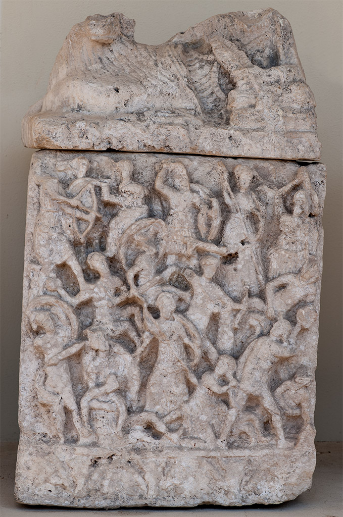 Cinerary urn of a woman with a scene of a battle between the Giants and the Gods. Travertine. 2nd century BCE. Inv. No. Bell. 134. Perugia, National Archaeological Museum of Umbria