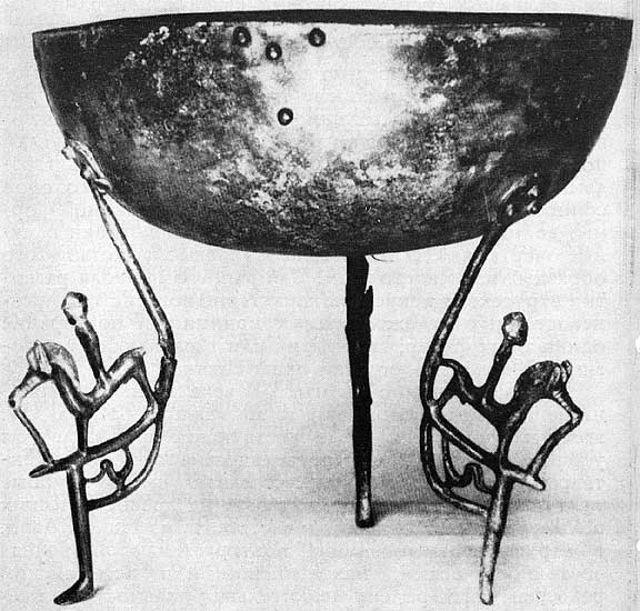 Vessel with figured legs from Vetulonia. Bronze. 7th century BCE. Florence, National Archaeological Museum