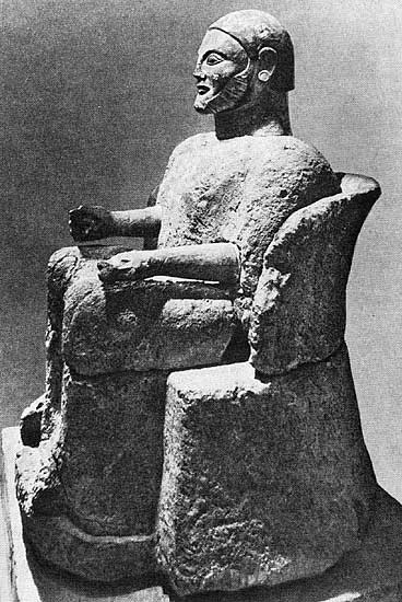 Canope urn in the form of a sitting man. Stone. 6th century BCE. Height — 1.35 m. Palermo, Regional Archaeological Museum