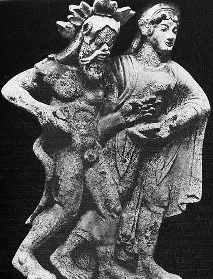 Antefix in the form of Silenus and maenad. Terracotta. 6th century BCE. Height — 0.6 m. Rome, National Etruscan Museum of Villa Julia