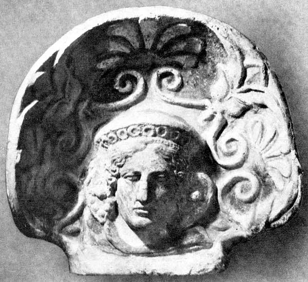 Antefix in the form of a maenad's head. Clay. 5th—4th centuries BCE. Kiev, Museum of Western and Oriental art