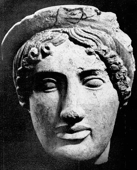 Female head from the sanctuary in Veii. Terracotta. 5th century BCE. Rome, National Etruscan Museum of Villa Julia