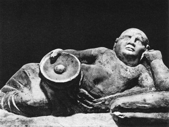 Feasting Etruscan, detail of funeral urn. Clay. 3rd century BCE. Chiusi, National Archaeological Museum