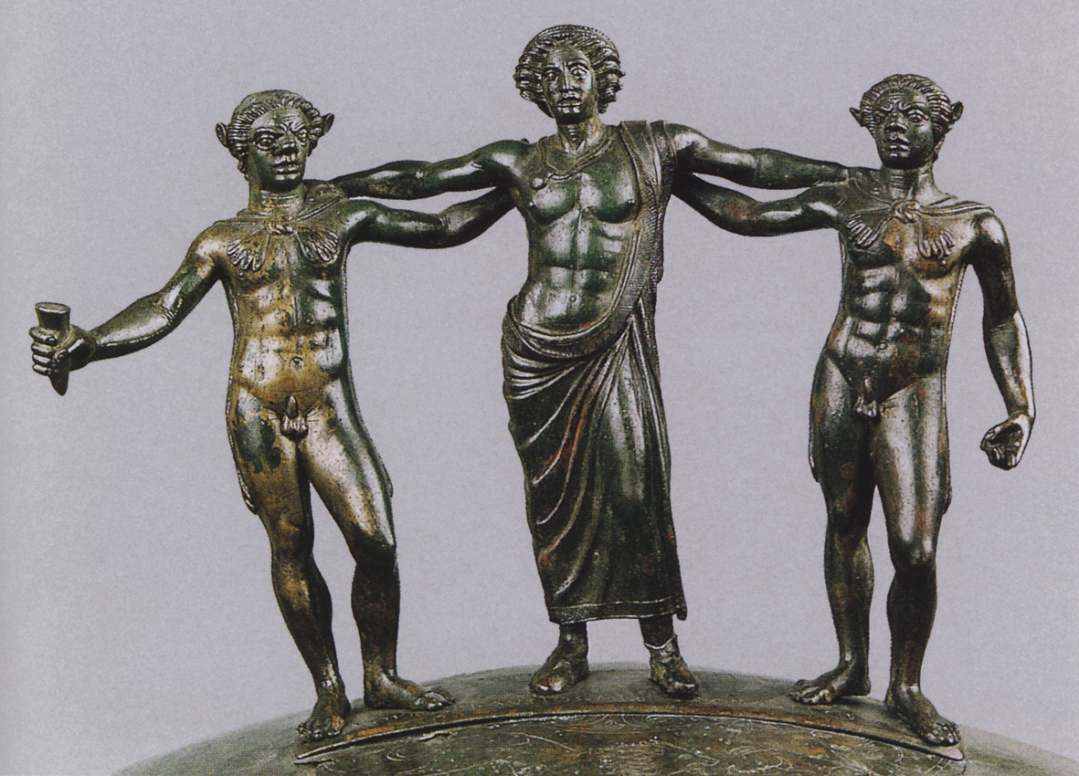 Dionysos with two satyrs. Handle of the Ficoroni Cist. Bronze. About 300 BCE. Rome, National Etruscan Museum of Villa Julia