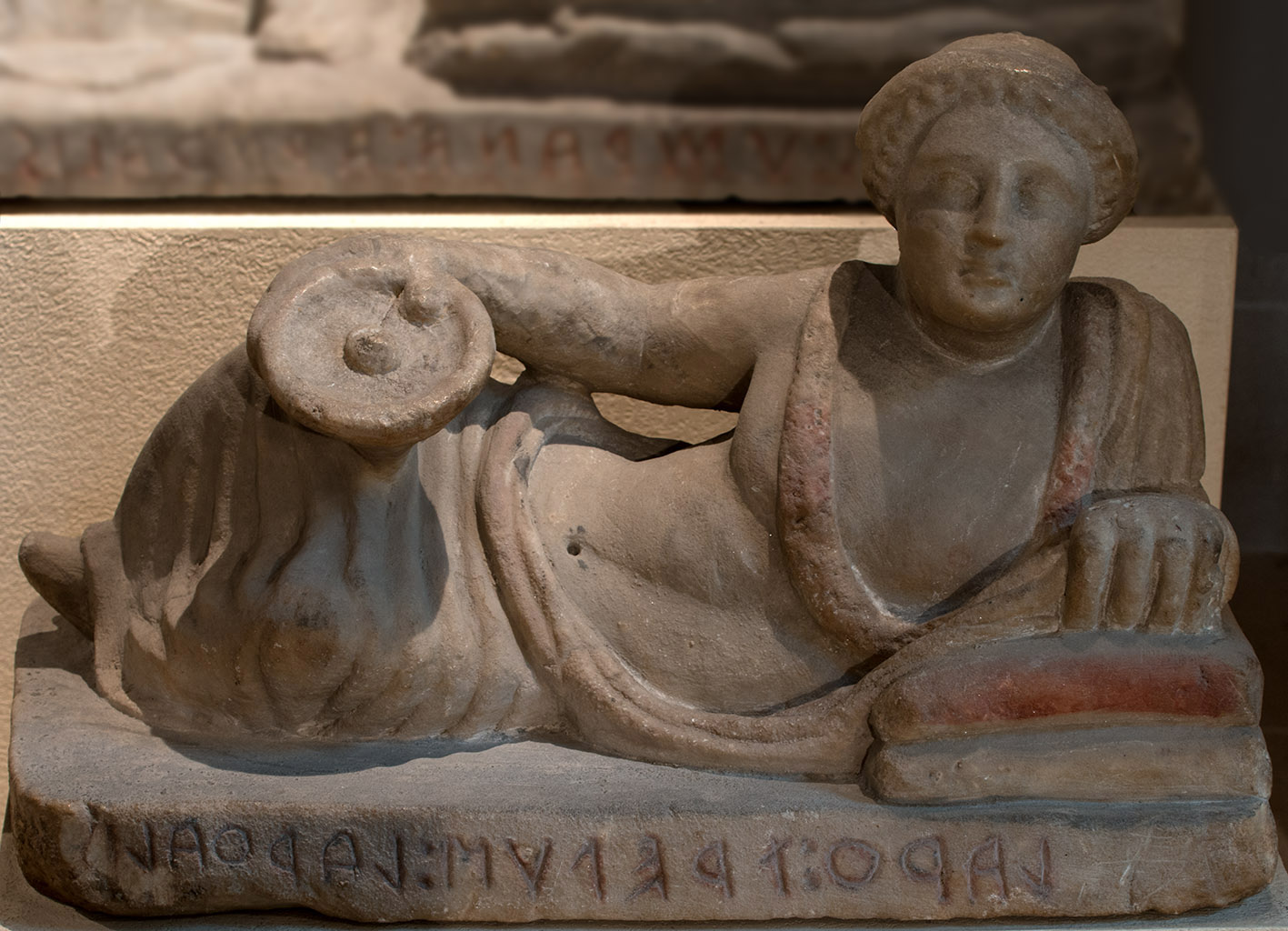 Lid of cinerary urn from Chiusi with a reclining deceased. Terracotta. Late 3rd — early 2nd century BCE. Paris, Louvre Museum