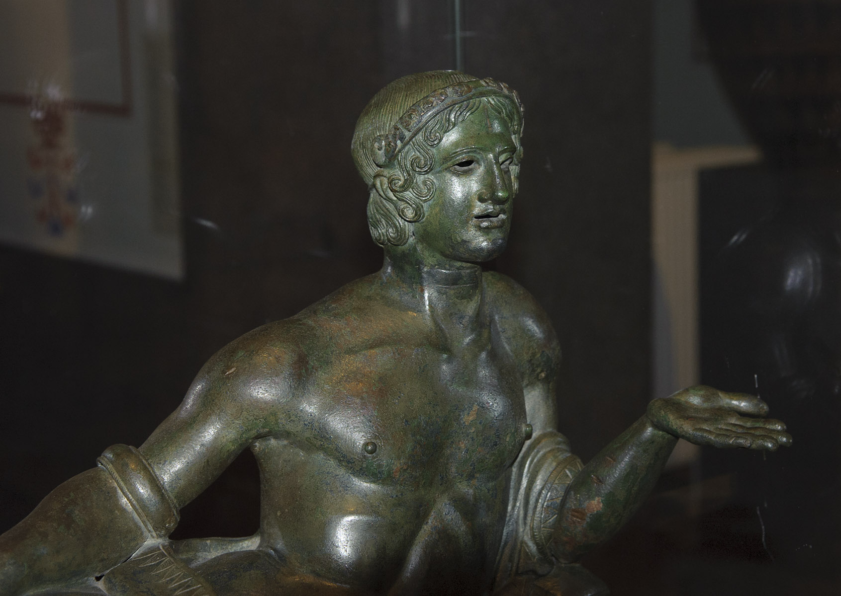 Reclining youth (close-up). Lid of cinerary urn. Bronze. Mid-4th century BCE. Inv. No. B 485. Saint Petersburg, The State Hermitage Museum