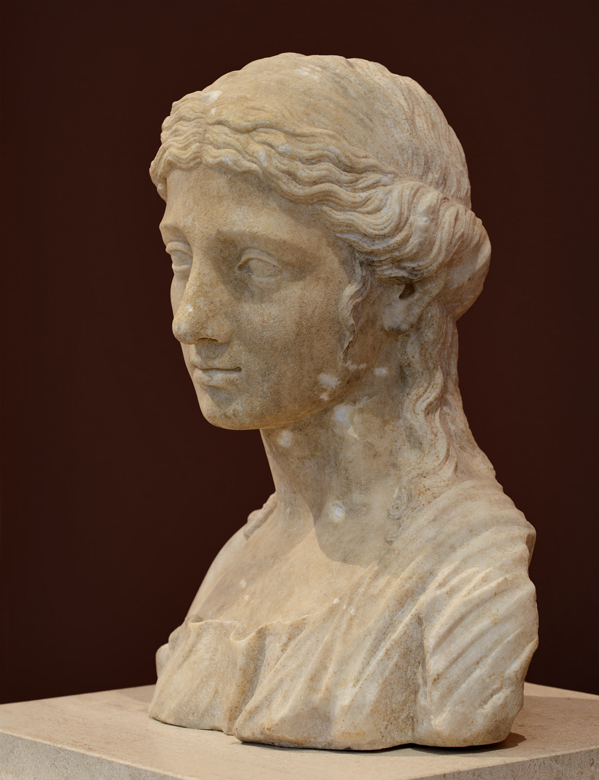 Female portrait. Fragment from a funerary monument. Marble. Patras. Augustan period. Patras, New Archaeological Museum