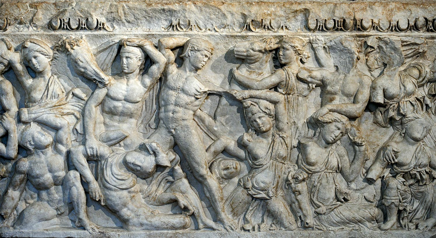 Front panel of Attic sarcophagus with a scene of Amazonomachy. Proconnesus or Hymettius marble. 2nd—3rd centuries CE. Inv. MR 10710. Brescia, Santa Giulia Civic Museum