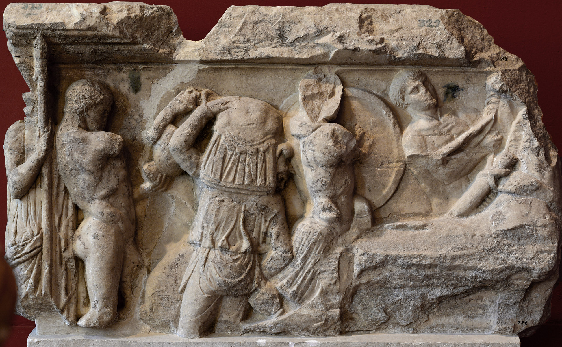 A fragment of front panel of a sarcophagus with a scene of ransoming of Hector's body. Marble. Late 2nd—early 3rd cent. CE. Inv. No. 322—323. Sparta, Archaeological Museum