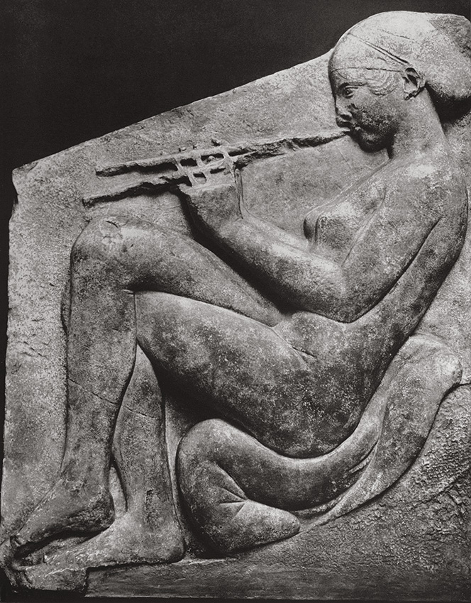 "A girl playing the flute. Altar of Aphrodite, so-called ""Ludovisi Throne."" Marble. First third of the 5th century BCE. Rome, Roman National Museum, Palazzo Altemps"