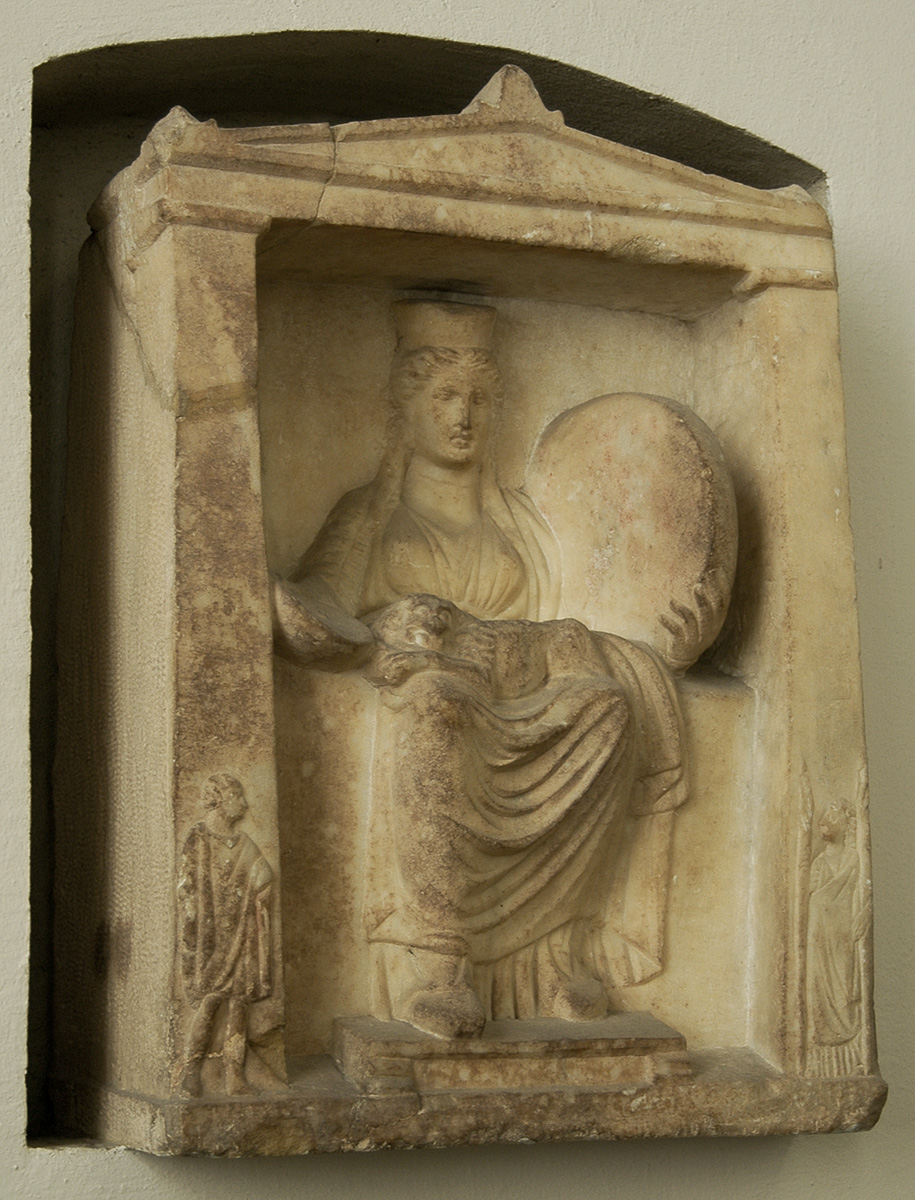 The naiskos with the figure of enthroned Kybele. (On antae is represented Hermes Kadmilos and Hecate.) Marble votive relief. Second half of the 4th century BCE. Berlin, State Museums, Pergamon Museum