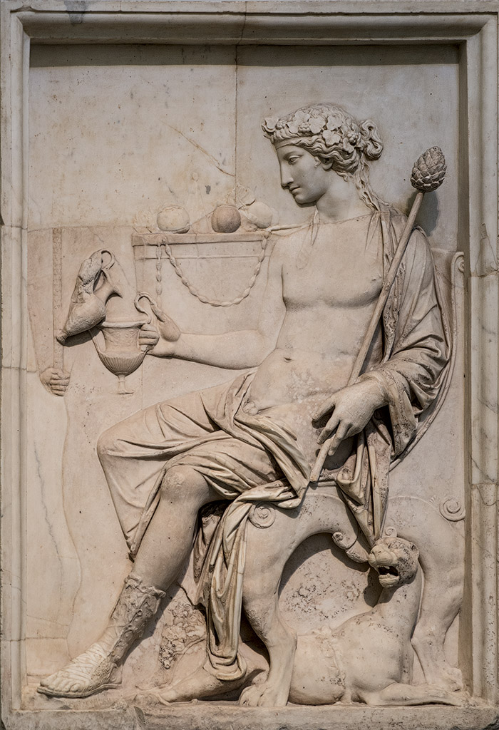 Sitting Dionysos. Neo-Attic relief. Marble. 1st cent. CE. Inv. No. 6728. Naples, National Archaeological Museum