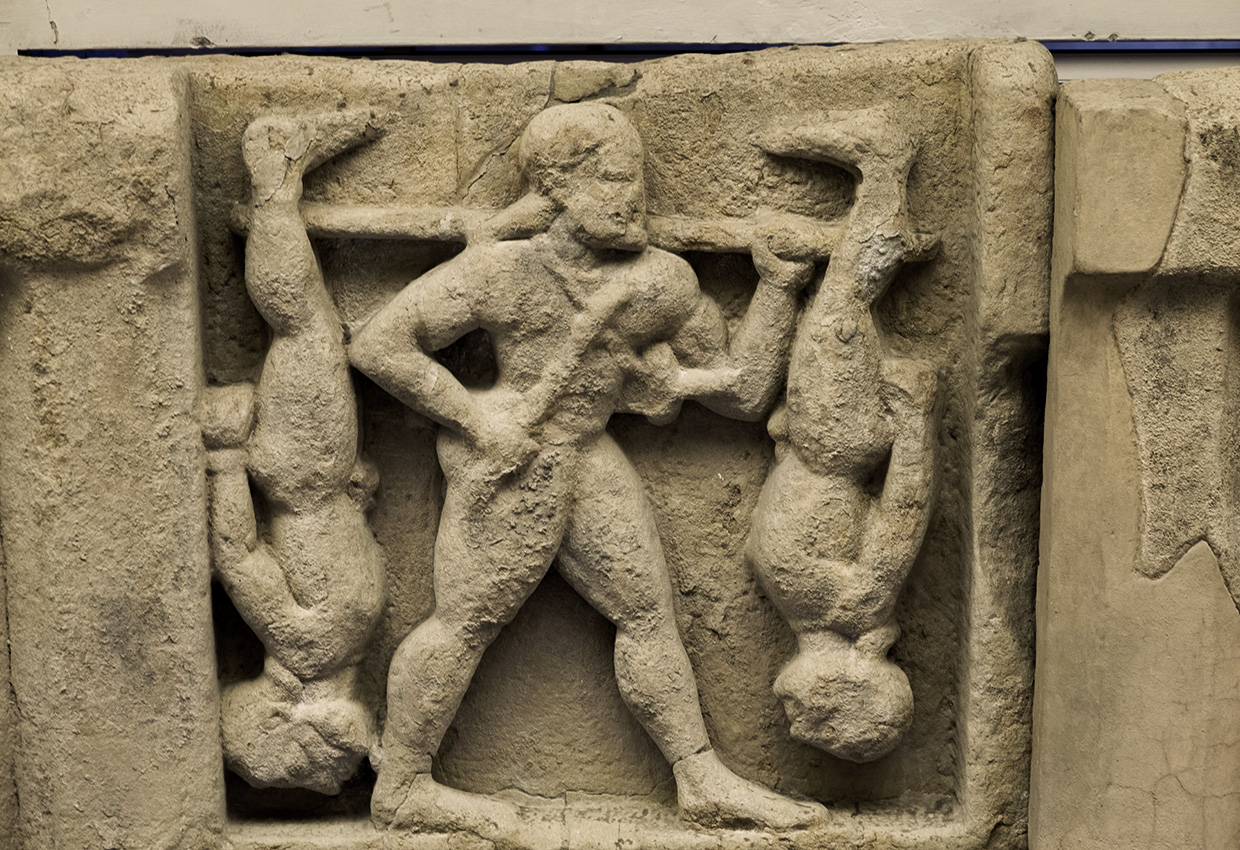 Heracles and the Cercopes. Sandstone. Metope from the temple of Hera at the mouth of the river Sele. Mid-6th century BCE. Paestum, National Archaeological Museum