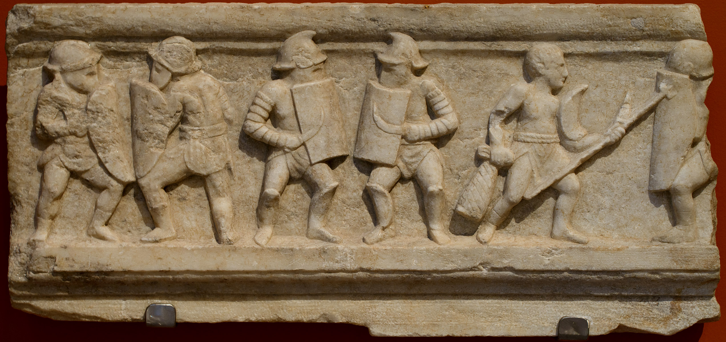 Base of a statue with a depiction of training of gladiators. Marble. Late 1st — early 2nd cent. CE. Inv. No. 1915. Patras, New Archaeological Museum