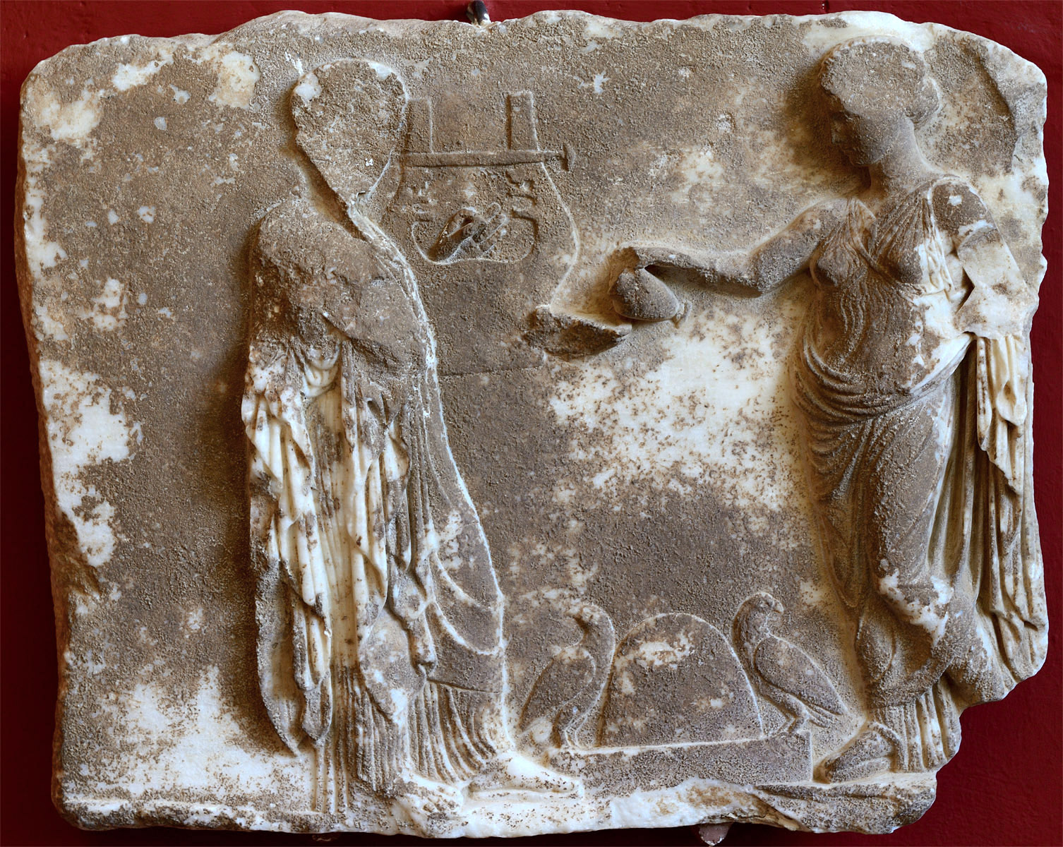 Apollo and Artemis offering a libation over the Delphic omphalos. Marble. Votive relief. 4th cent. CE. Inv. No. 468. Sparta, Archaeological Museum