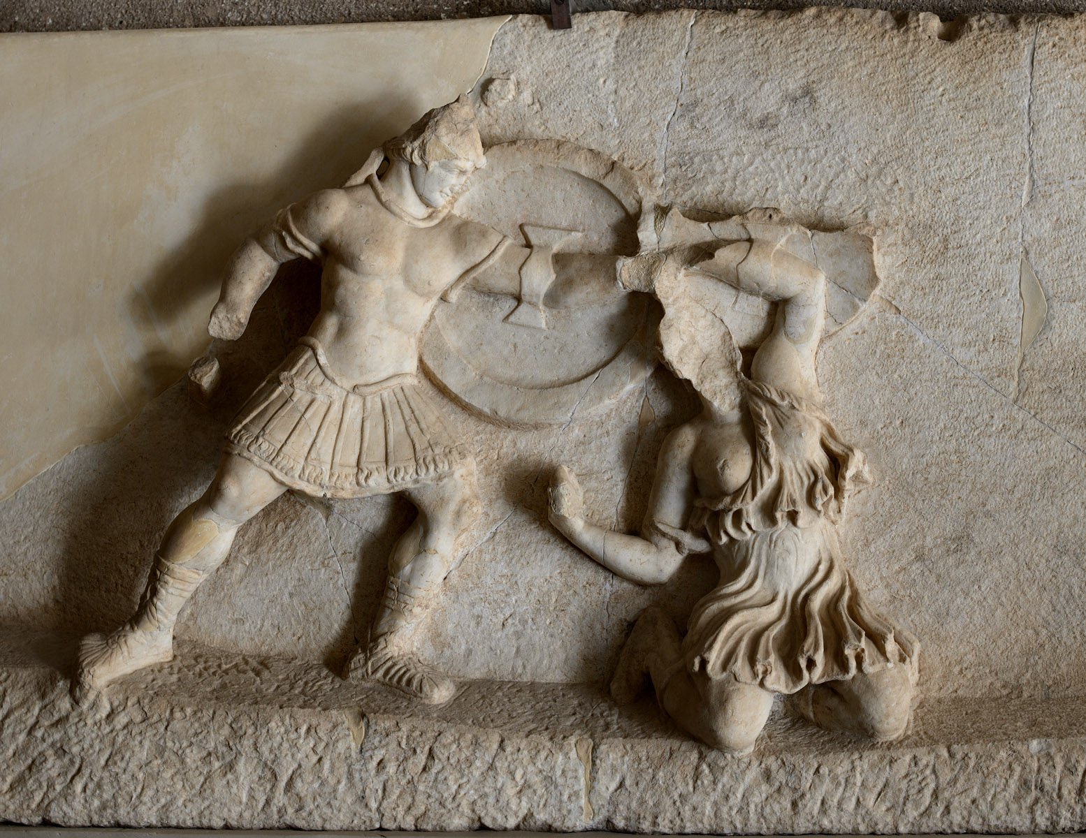 Scene of amazonomachia (Greek fighting a kneeling amazon). Marble. Mid-2nd cent. CE. Corinth, Archaeological Museum of Ancient Corinth