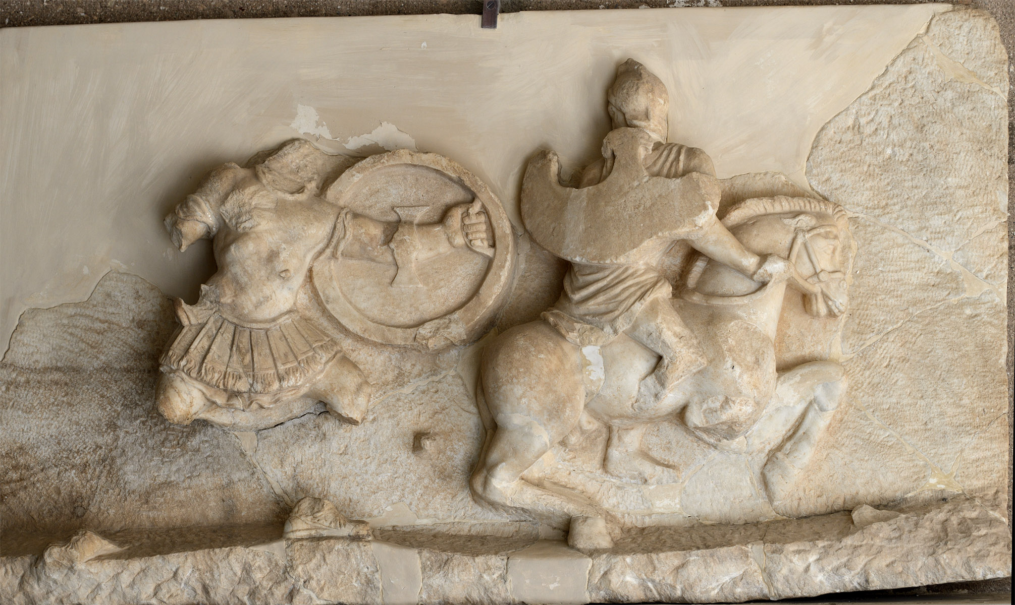 Scene of amazonomachia (cuirassed Greek chasing mounted Amazon). Marble. Mid-2nd cent. CE. Corinth, Archaeological Museum of Ancient Corinth