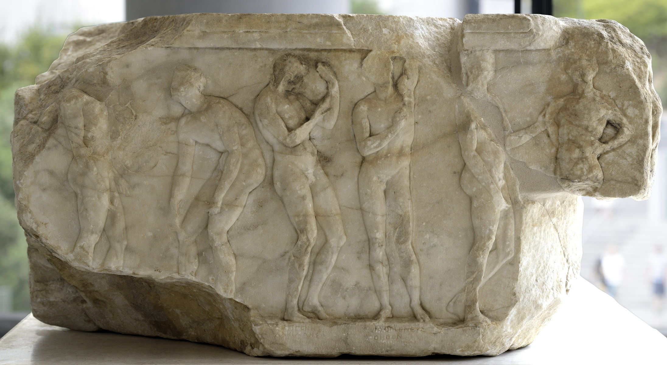 Base of a dedication statue with a depiction of athlets after the contest. Marble. 330 BCE. Inv. No. Acr. 3176. Athens, New Acropolis Museum