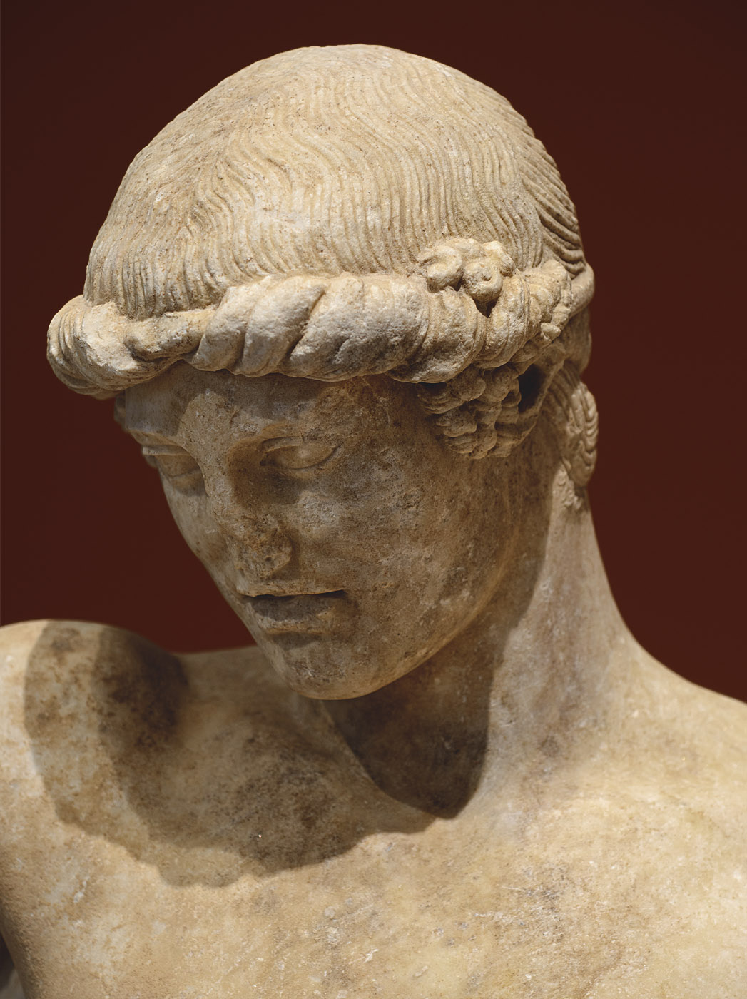 Statue of a young man (Apollo?) — close-up. Marble. Roman copy after a Greek original (middle of 1st cent. BCE). Patras, New Archaeological Museum