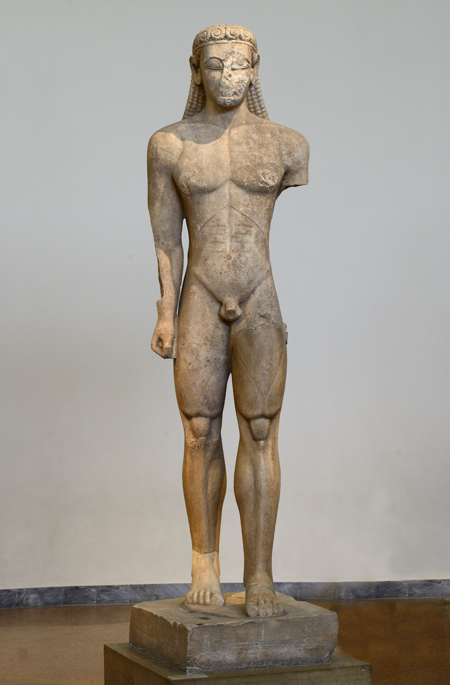 Kouros (a votive offering to Poseidon). Naxian marble. Ca. 600 BCE. Inv. No. 2720. Athens, National Archaeological Museum