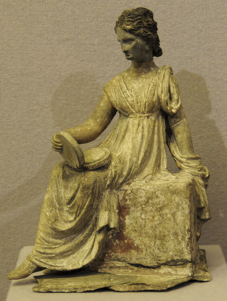 Sitting young woman with mirror. Terracotta. 3rd century BCE. Inv. No. Г. 563. Saint Petersburg, The State Hermitage Museum