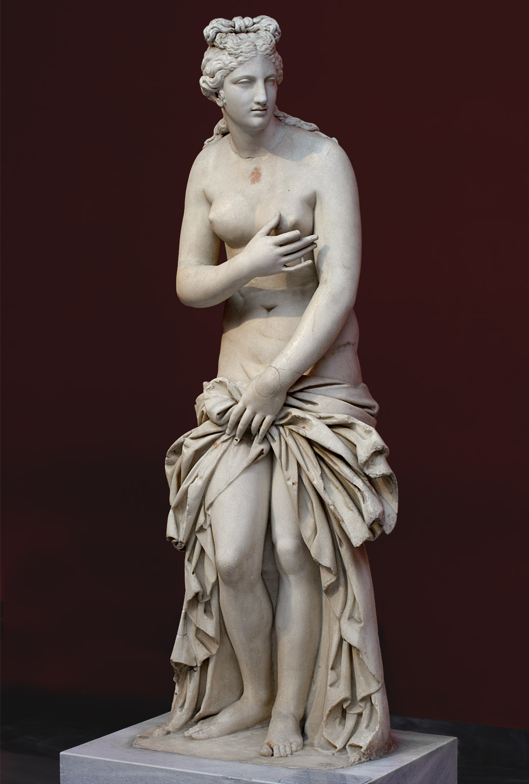 "Aphrodite (type ""Aphrodite of Syracuse""). Parian marble. Copy of the 2nd century CE after a Greek original of the 4th cent. BCE. Inv. No. 3524. Athens, National Archaeological Museum"