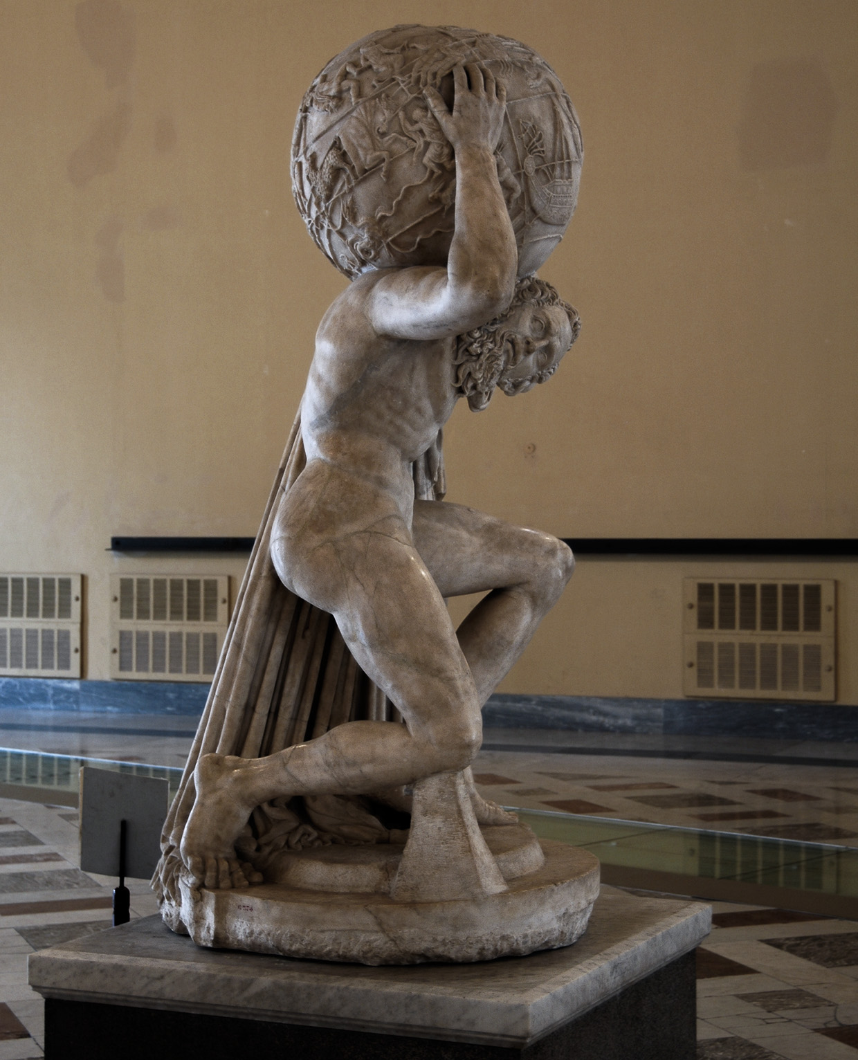 Statue of Atlas holding the celestial sphere (Farnese Atlas). Marble. Roman copy of a Greek sculpture of the 2nd cent. BCE. Inv. No. 6374. Naples, National Archaeological Museum