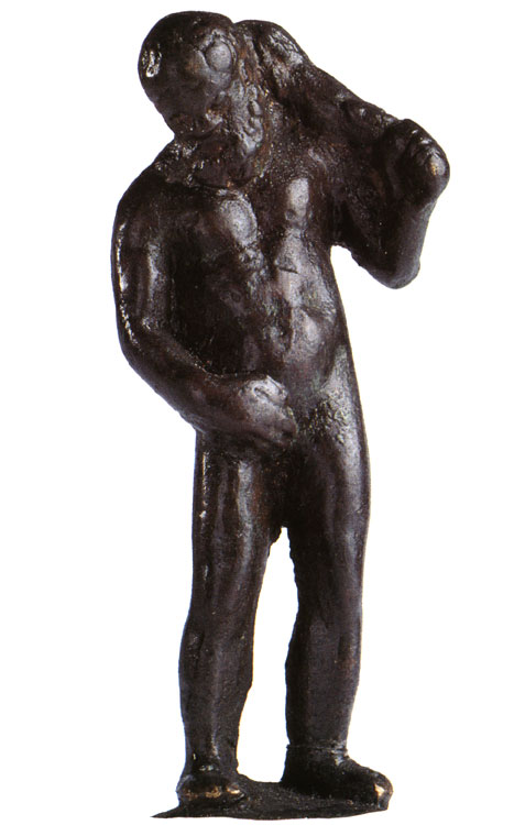Statuette of Heracles mingens. Bronze, dark green, solid cast. 1st century BCE — 1st century CE. Height 5.8 cm. Inv. No. Б. 307. Saint Petersburg, The State Hermitage Museum