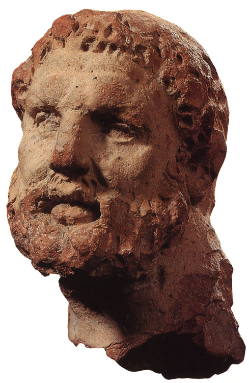 Head of Heracles. Solid terracotta. 3rd century BCE. Height 9 cm. Inv. No. Х.1974.80. Saint Petersburg, The State Hermitage Museum