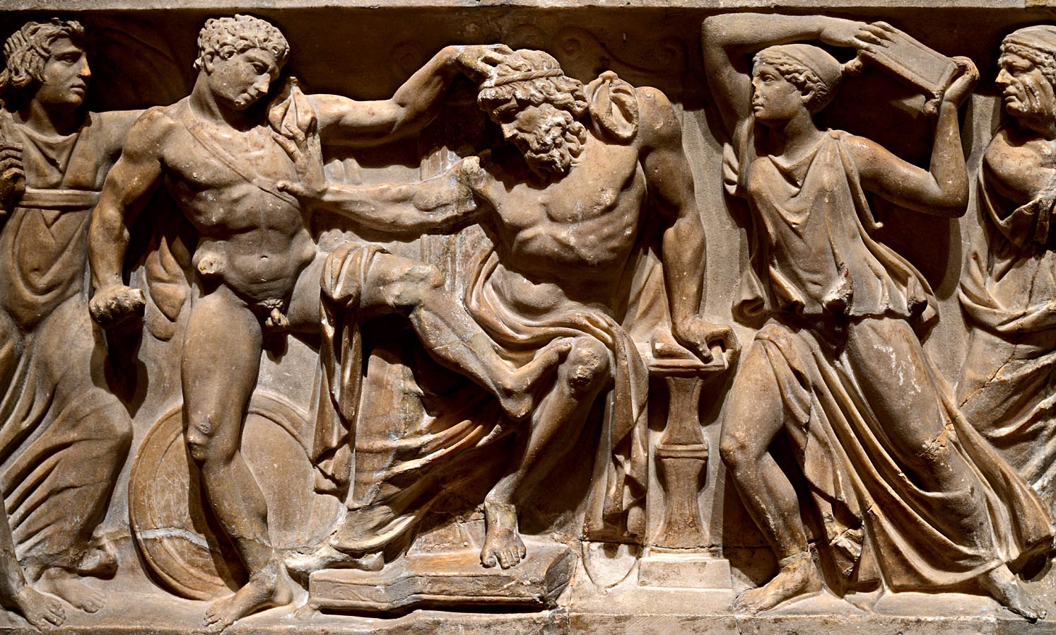 """Orestes slaying Aegisthus (a close-up of relief """"Orestes slaying Aegisthus and Clytemnestra""""). Frontal relief of a sarcophagus. Rome. Marble. Ca. 150 CE. Inv. No. A 461. Saint Petersburg, The State Hermitage Museum"""