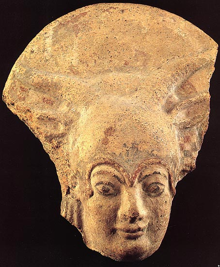Terracotta antefix, representing the head of Juno Lanuvian. Early 5th century BCE. Rome, National Etruscan Museum of Villa Julia