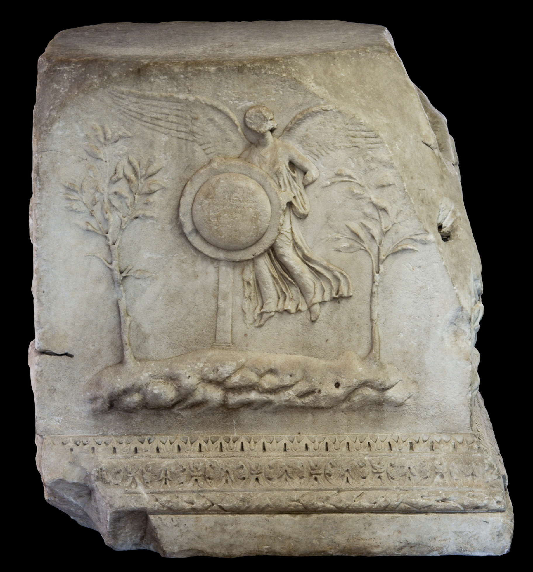 Altar of the Lares Augusti. Winged Victory with the Clupeus Virtutis. Marble. 12—2 BCE. Inv. No. 1115. Rome, Vatican Museums, Gregorian Profane Museum