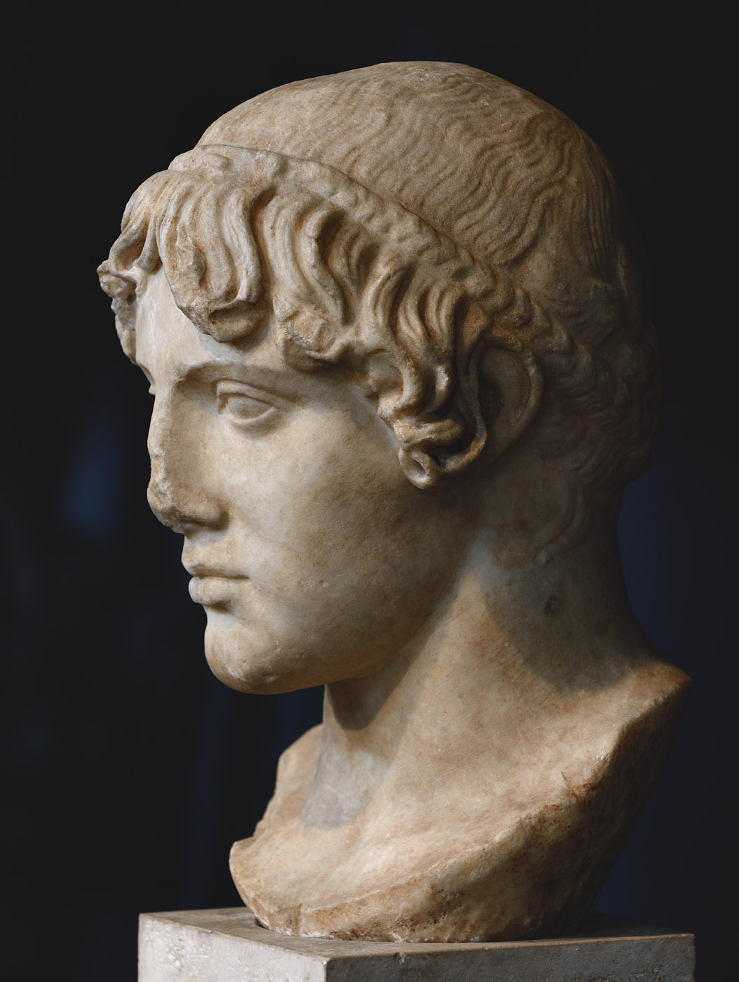 Head of Apollo (the so-called Omphalos). Luna marble. Roman copy after a Greek statue by Kalamis of the 5th century BCE.  Inv. No. MC 3046. Rome, Capitoline Museums, Museum Montemartini (Centrale Montemartini), II. 25